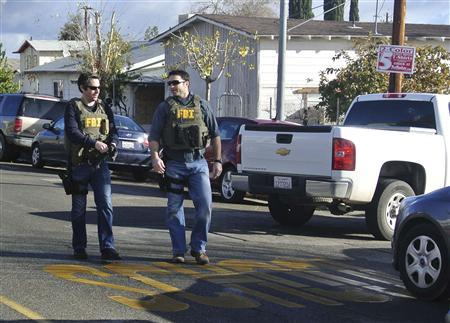 Law enforcement officers wearing FBI vests arrive on the scene after a shooting at Taft Union High School in Taft, California January 10, 2013. REUTERS/Michael Long/The Taft Independent
