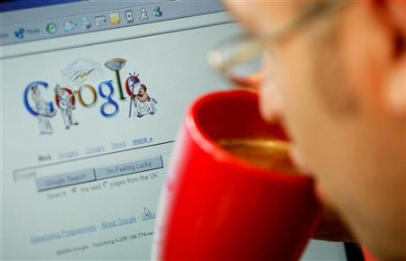 - FILE PHOTO TAKEN 13AUG04 - An internet surfer views the Google home page at a cafe in London in this August 13, 2004 file photo. REUTERS/Stephen Hird/Files