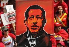 Supporters of Venezuelan President Hugo Chavez attend a rally outside Miraflores Palace in Caracas January 10, 2013. REUTERS/Carlos Garcia Rawlins