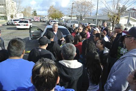 Taft Police Chief Ed Whiting speaks to concerned parents after a shooting at Taft Union High School in Taft, California January 10, 2013. REUTERS/Michael Long/The Taft Independent