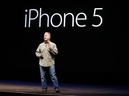 Phil Schiller, senior vice president of worldwide marketing at Apple Inc., introduces the iPhone 5 during Apple Inc.'s iPhone media event in San Francisco, California September 12, 2012. REUTERS/Beck Diefenbach