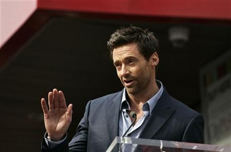 Actor Hugh Jackman speaks during ceremonies honoring him with a star on the Hollywood Walk of Fame in Hollywood, California, December 13, 2012. REUTERS/Jonathan Alcorn/Files