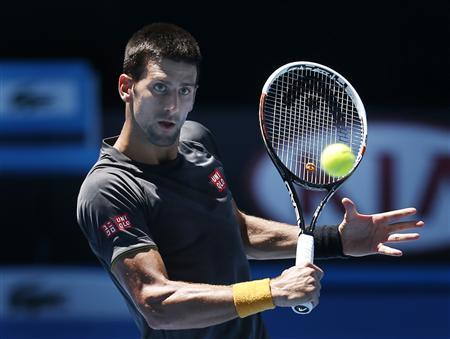 Serbia's Novak Djokovic hits the ball during a practice session at Melbourne Park January 10, 2013, ahead of the Australian Open tennis tournament which begins on Monday. REUTERS/Tim Wimborne