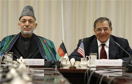 President of Afghanistan Hamid Karzai (L) sits with U.S. Defense Secretary Leon Panetta (R) for their meeting at the Pentagon in Arlington, Virginia, January 10, 2013. REUTERS/Jonathan Ernst