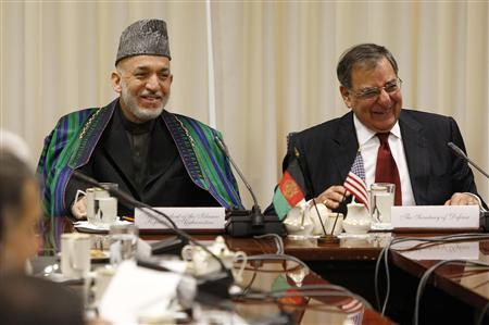 U.S. Defense Secretary Leon Panetta (R) and President of Afghanistan Hamid Karzai (L) smile at a remark by Karzai before their meeting at the Pentagon in Arlington, Virginia, January 10, 2013. REUTERS/Jonathan Ernst