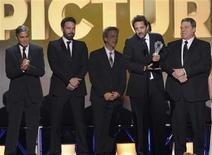 "Producer Grant Heslov accepts the award for ""Best Picture"" for ""Argo"" along with other members of the production at the 2013 Critics' Choice Awards in Santa Monica, California, January 10, 2013. REUTERS/Mario Anzuoni"