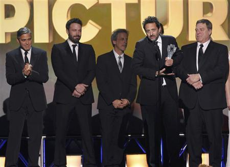 Producer Grant Heslov accepts the award for ''Best Picture'' for ''Argo'' along with other members of the production at the 2013 Critics' Choice Awards in Santa Monica, California, January 10, 2013. REUTERS/Mario Anzuoni