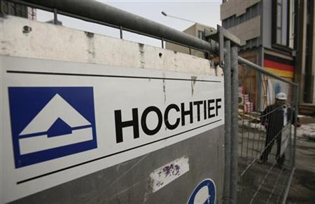 A security man closes the entrance to a building site of a new skyscraper of German construction group Hochtief in Frankfurt January 4, 2011. Spanish builder ACS has secured a crucial 30 percent holding in Hochtief following a hotly contested takeover bid, allowing it to build a controlling interest in the German construction group. REUTERS/Wolfgang Rattay (GERMANY - Tags: BUSINESS)
