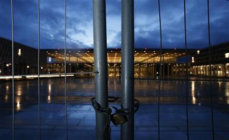 A lock closes a fence at the entrance to the main terminal building at the construction site of the future Berlin Brandenburg international airport Willy Brandt (BER) in Schoenefeld January 10, 2013. Germans take pride in their engineering and organisational skills but their country's reputation for efficiency has been exploded by a farcical series of delays in building Berlin's new international airport. REUTERS/Tobias Schwarz (GERMANY - Tags: TRAVEL SOCIETY TRANSPORT)