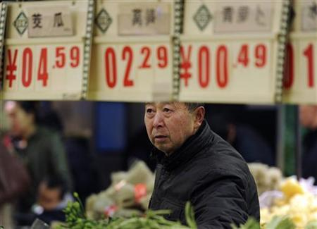 A customer looks at price tags at the vegetable section of a supermarket in Hefei, Anhui province, December 9, 2012. China's annual consumer inflation rebounded from 33-month lows to 2 percent in November, dimming the chance for more monetary policy easing as its economy recovers. REUTERS/Stringer (CHINA - Tags: BUSINESS)