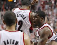Portland Trail Blazers shooting guard Wesley Matthews (R) celebrates with teammates LaMarcus Aldridge (12) and Nicolas Batum (88) after defeating the Miami Heat in NBA basketball game in Portland, Oregon, January 10, 2013. REUTERS/Steve Dipaola