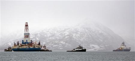 Salvage teams conduct an assessment of Shell's Kulluk drill barge on Kodiak Island's Kiliuda Bay in Alaska January 9, 2013, in this picture provided by Greenpeace. REUTERS/Tim Aubry/Greenpeace/Handout