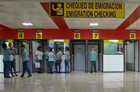 Immigration officers wait for travellers at the control checkpoint at Havana's Jose Marti International Airport October 16, 2012. REUTERS/Desmond Boylan