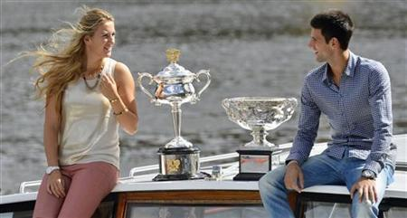 Victoria Azarenka of Belarus, the 2012 Australian Open women's singles champion, and Novak Djokovic of Serbia, the 2012 Australian Open men's singles champion, pose with their trophies before the official draw of the 2013 Australian Open tennis tournament in Melbourne January 11, 2013. REUTERS/Toby Melville