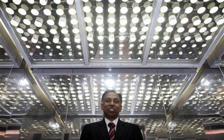 Infosys Chief Executive S.D. Shibulal poses for a picture after an interview with Reuters near his office inside their campus in the Electronic City area in Bangalore September 4, 2012. REUTERS/Vivek Prakash/Files