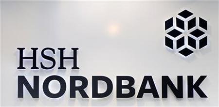 The HSH Nordbank logo is pictured in Hamburg December 7, 2012. Troubled shipping lender HSH Nordbank forecast more pain on Wednesday saying it does not expect a recovery in the shipping industry to begin before the end of 2013. The German public-sector bank, which is one of the world's biggest ship financiers, told investors it does not expect the slump to bottom out for another 1-1.5 years. REUTERS/Fabian Bimmer (GERMANY - Tags: BUSINESS MARITIME)