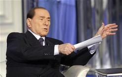 Il leader del Pdl Silvio Berlusconi durante una trasmissione televisiva. REUTERS/Remo Casilli