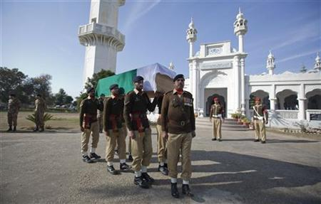Soldiers carry the flag-draped casketof their colleague Havildar Ghulam Mohyuddin, whom the Pakistan military said was killed by Indian soldiers while manning a post on the Line of Control (LoC) near Tatta Pani (Hot-Water) in the Battal sector of the disputed region of Kashmir, during his funeral at a garrison mosque in Jhelum January 11, 2013. REUTERS/Mian Khursheed