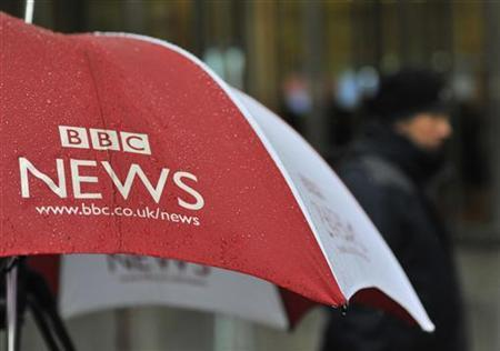 A BBC umbrella protects broadcast equipment outside the BBC's New Broadcasting House in London December 19, 2012. REUTERS/Toby Melville/Files