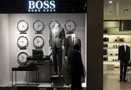 File picture shows a man as he looks at a shop window outside the Hugo Boss showroom inside a shopping mall in Mumbai August 23, 2011. REUTERS/Danish Siddiqui/File