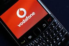 A Vodafone logo is seen on a Blackberry phone in London November 9, 2010. Vodafone. REUTERS/Suzanne Plunkett