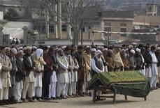 People attend funeral prayers for a victim who was killed by a bomb blast, in Mangora, Swat valley January 11, 2013. REUTERS/Hazrat Ali Bacha (PAKISTAN - Tags: POLITICS CIVIL UNREST OBITUARY)