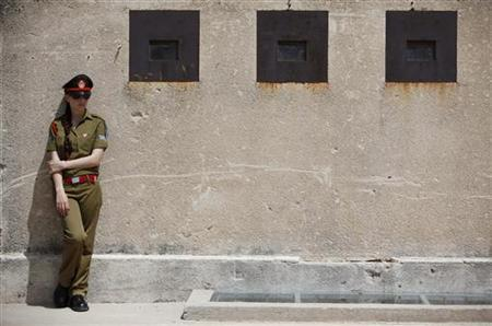 An Israeli soldier waits for her turn to take part in a Memorial Day ceremony at the Israeli army's Armoured Corps Memorial in Latrun, near Jerusalem April 19, 2010. REUTERS/Nir Elias/Files