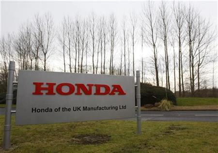 A sign is seen outside the Honda manufacturing plant in Swindon, western England January 30, 2009. REUTERS/Stephen Hird