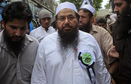 Hafiz Saeed (C), the head of Jamaat-ud-Dawa organisation and founder of Lashkar-e-Taiba, arrives to take part in a protest rally in Lahore July 8, 2012. REUTERS/Mohsin Raza/Files