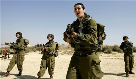 Israeli platoon commander Racheli Levantal (2nd R) of the Karakal ground Battalion, made up of male and female combat soldiers, shouts instructions during a training session at a military base in southern Israel, in this February 12, 2007 file picture. REUTERS/Eliana Aponte/Files