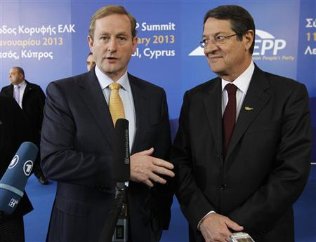 Ireland's Prime Minister Enda Kenny (L) talks to journalists with Cyprus' presidential race's forerunner and president of the right-wing Democratic Rally party Nicos Anastasiades upon his arrival at a European People's Party (EPP) summit in the Cypriot town of Limassol January 11, 2013. REUTERS/Jamal Saidi