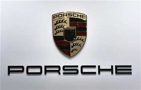 A logo is seen on the Porsche booth on media day at the Paris Mondial de l'Automobile September 27, 2012. The Paris auto show opens its doors to the public from September 29 to October 14. REUTERS/Jacky Naegelen