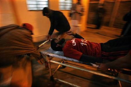 People wheel an injured rescue worker into a hospital after the second bomb blast in Quetta January 10, 2013. REUTERS/Naseer Ahmed