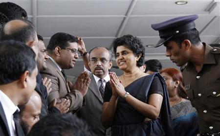 Chief Justice Shirani Bandaranayake (2nd R) gestures as she leaves the Supreme Court for the Parliament to appear before the Parliamentary Select Committee (PSC) appointed to look into impeachment charges against her, in Colombo December 4, 2012. REUTERS/Stringer/Files