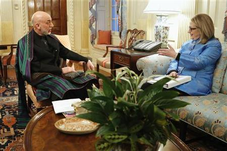 President of Afghanistan Hamid Karzai (L) sits with U.S. Secretary of State Hillary Clinton in her outer office at the State Department in Washington, January 10, 2013. REUTERS/Jonathan Ernst