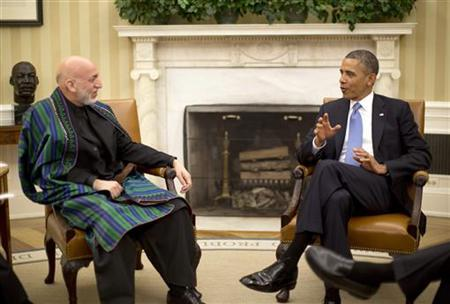 U.S. President Barack Obama meets with Afghanistan's President Hamid Karzai in the Oval Office of the White House in Washington, January 11, 2013. REUTERS/Jason Reed