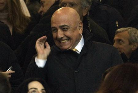 AC Milan's manager Adriano Galliani smiles before their match against Inter Milan in their Serie A match at San Siro stadium in Milan January 15, 2012. REUTERS/Stefano Rellandini