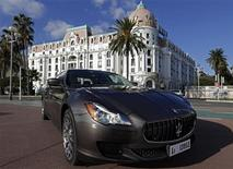 A new Maserati Quattroporte car is displayed on the Promenade des Anglais in Nice, in this December 10, 2012 file photo. Fiat's luxury brand, Maserati, will unveil a newly redesigned Quattroporte sedan at the Detroit auto show, which begins on January 13. REUTERS/Eric Gaillard/Files