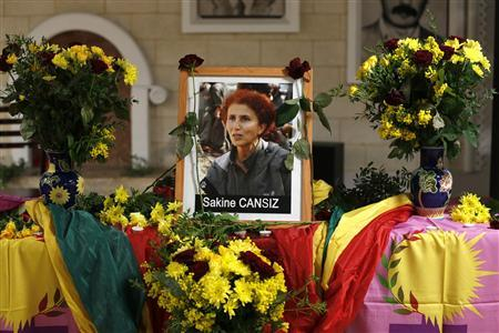 A portait of late PKK activist Sakine Cansiz is seen at the Kurdish cultural centre in Paris, after three Kurdish women were found shot dead, January 10, 2013. Three female Kurdish activists including a founding member of the PKK rebel group were shot dead in Paris overnight in execution-style killings condemned by Turkish politicians trying to broker a peace deal. REUTERS/Charles Platiau