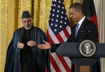 U.S. President Barack Obama (R) welcomes Afghan President Hamid Karzai prior to a joint news conference in the East Room of the White House in Washington, January 11, 2013. REUTERS/Larry Downing