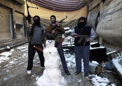 Members of the Free Syrian Army pose with their weapons and a snowman at the Jouret al Shayah area in Homs January 10, 2013. Picture taken January 10, 2013. REUTERS/Yazan Homsy