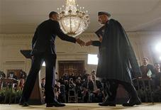 U.S. President Barack Obama (L) and Afghanistan President Hamid Karzai shake hands at the conclusion of a news conference at the White House in Washington January 11, 2013. REUTERS/Kevin Lamarque