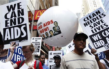 Demonstrators march at a rally during the United Nations' High Level Meeting on HIV & AIDS at the UN headquarters in this New York June 8, 2011 file photo. REUTERS/Shannon Stapleton/Files (UNITED STATES - Tags: HEALTH CIVIL UNREST)