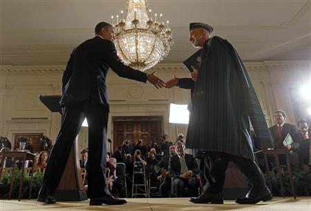 Obama, Karzai accelerate end of U.S. combat role in Afghanistan