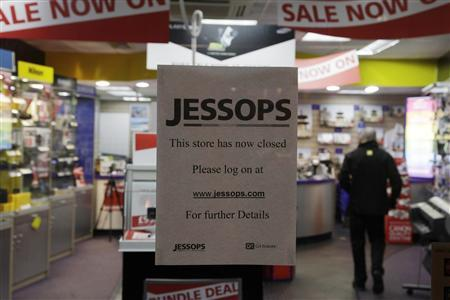 A note is seen on a door of a closed Jessops store in south London January 11, 2013. Jessops, the British camera retailer that went into administration on Wednesday, said it was closing all 187 of its stores on Friday, resulting in about 1,370 job losses. REUTERS/Stefan Wermuth