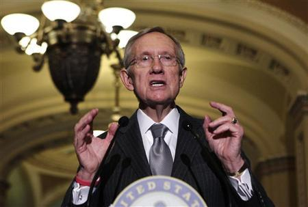 Senate Majority Leader Harry Reid (D-NV) speaks to the media about the ''fiscal cliff'' on Capitol Hill in Washington December 18, 2012. REUTERS/Yuri Gripas