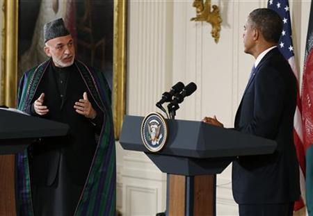 Afghan President Hamid Karzai and U.S. President Barack Obama (R) address a joint news conference in the East Room of the White House in Washington, January 11, 2013. REUTERS/Kevin Lamarque
