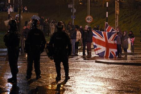 Protesters waving a Union flag block the O'Neil road during rioting in South Belfast, January 11, 2013. Violent protests continue in Northern Ireland as loyalists renewed their anger against restrictions on flying the union flag from Belfast City Hall. REUTERS/Cathal McNaughton