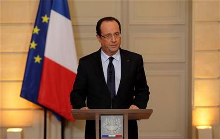 France's President Francois Hollande arrives to deliver a statment on the situation in Mali at the Elysee Palace in Paris, January 11, 2013. REUTERS/Philippe Wojazer