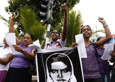 Demonstrators hold up an image of Rizana Nafeek as they shout slogans during a protest against her execution, in Colombo January 11, 2013. REUTERS/Dinuka Liyanawatte
